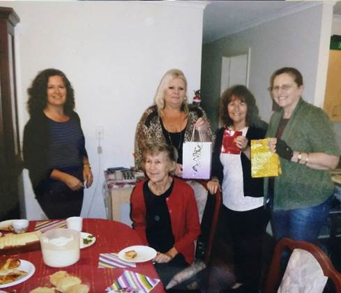 Penny with four ladies holding gift bags