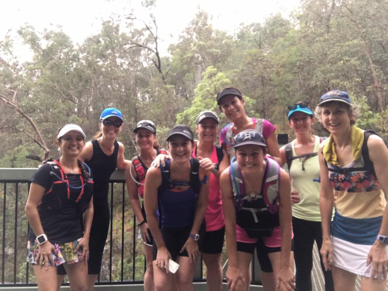 Cinta Graves with a group of runners at Mt Coot-tha