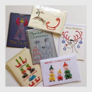 A variety of the hand-stitched Christmas cards with Braille