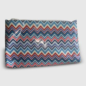 Cosmetic bag with zigzag pattern in blues and reds