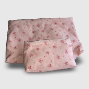 Cosmetic bags with pattern of flowers on pink background