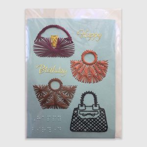 "Brailled ""Happy birthday"" card with hand stitched handbags on blue card"