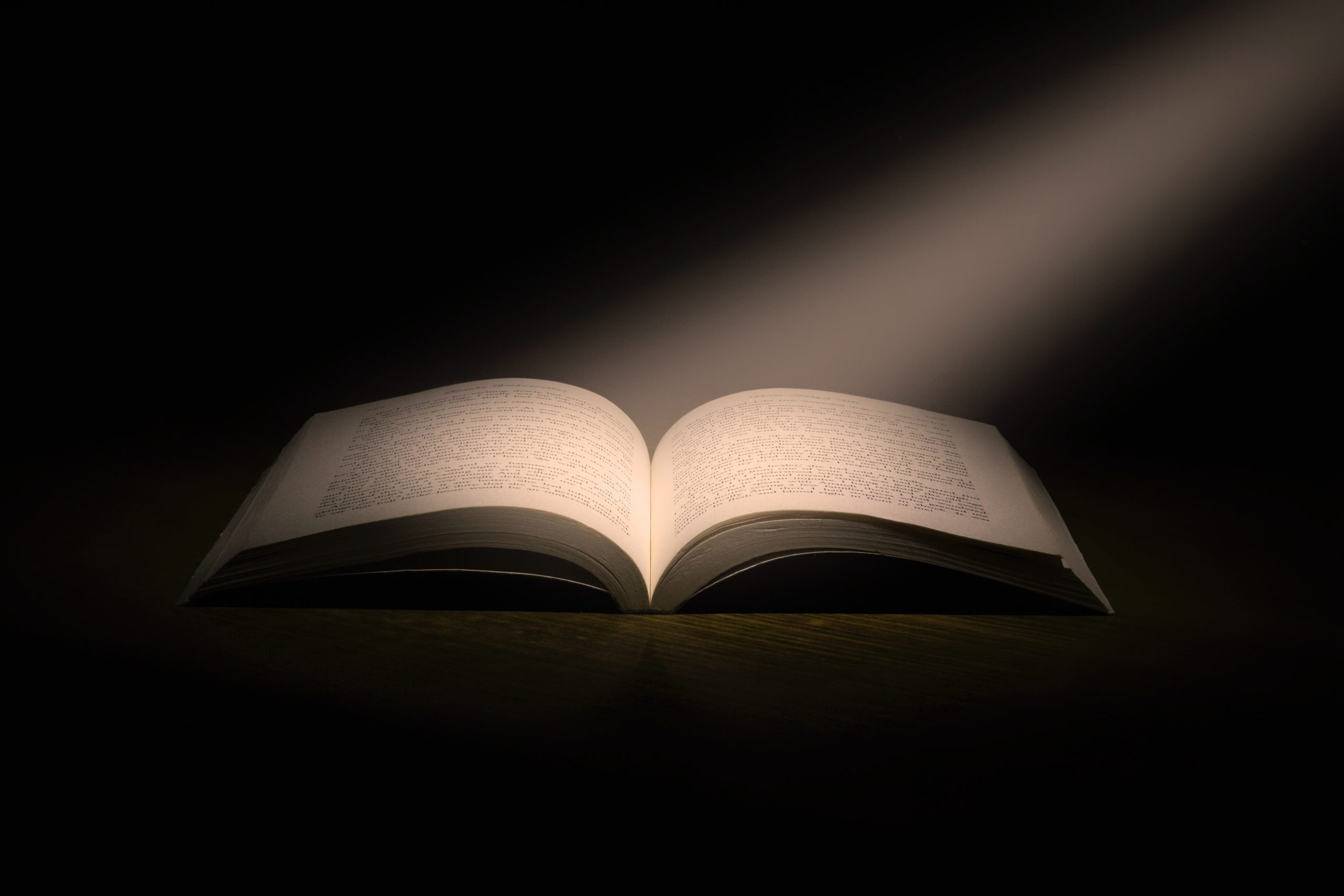 open book with light on the pages